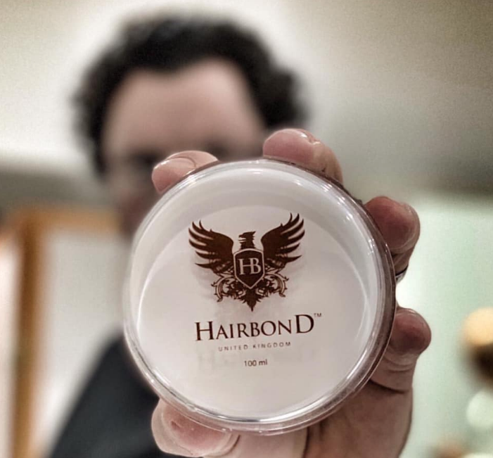 hairbond gripper pomade in hand